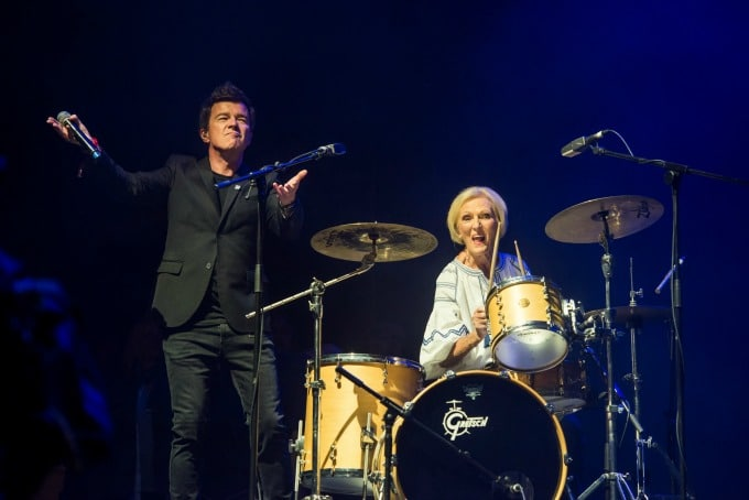 Rick Astley on stage with Mary Berry drumming at Camp Bestival 2018