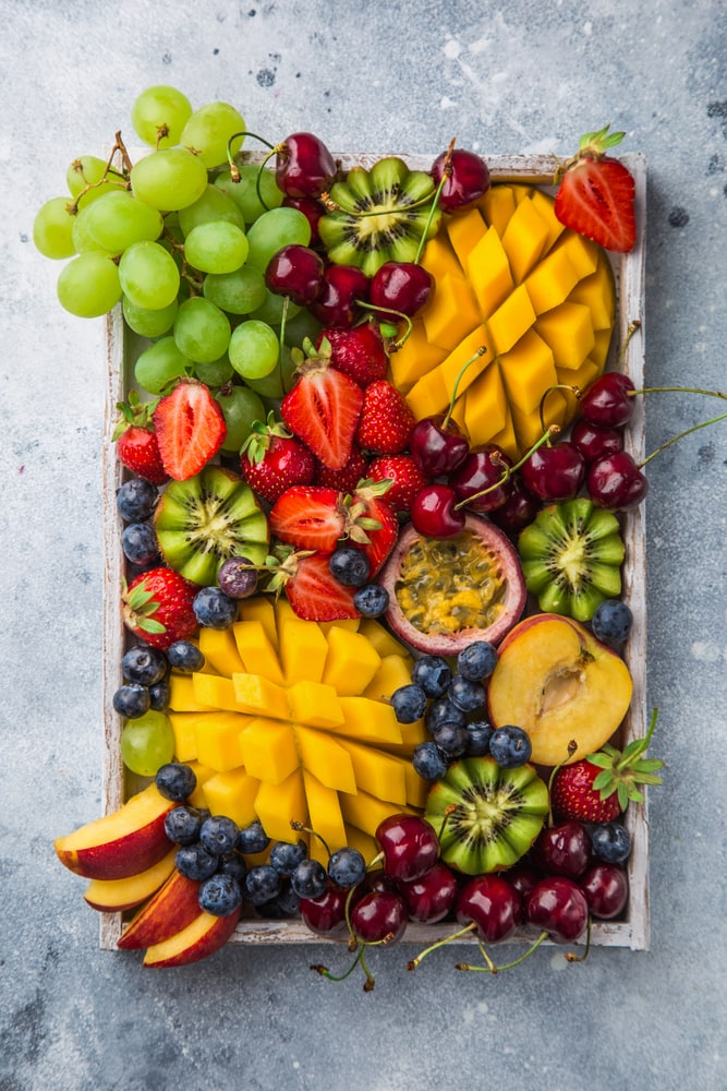 Fresh fruit platter on a grey backdrop