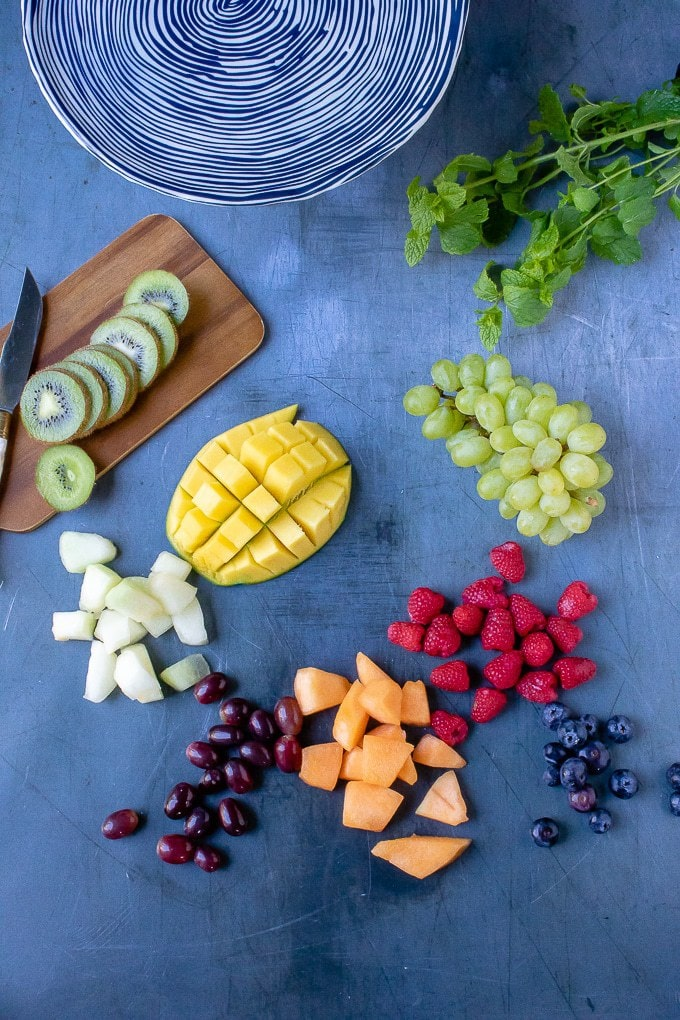 Ingredients laid out for the ultimate fruit platter recipe