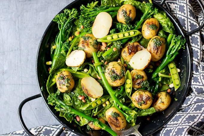 A bowl of pea potato broccoli salad with herb dressing. Vegan and gluten free.