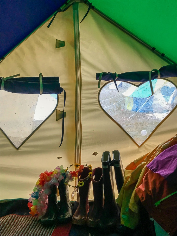 Inside a Podpads Bellepad 4 person bell tent with heart windows and wellies