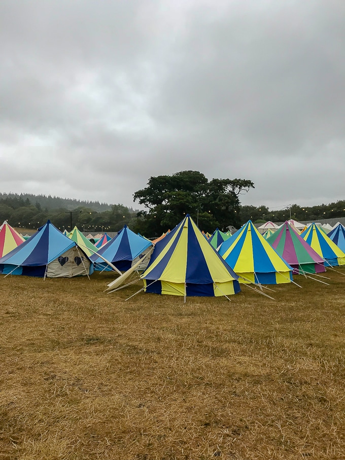 Rows of brightly coloured bell tents - Bellepads by Podpads at Camp Bestival 2018