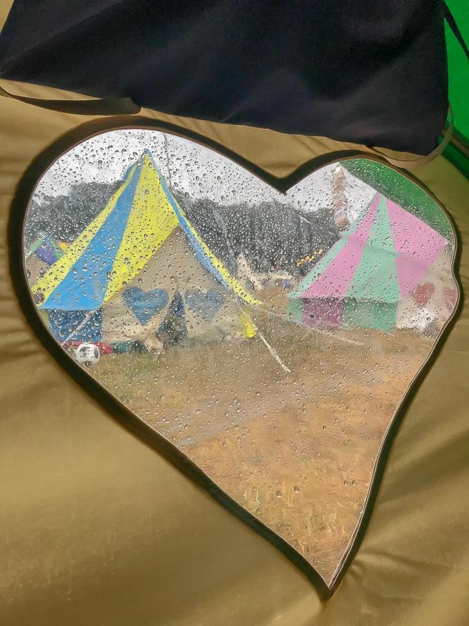 View through a heart shaped window from a Podpads Bellepad bell tent
