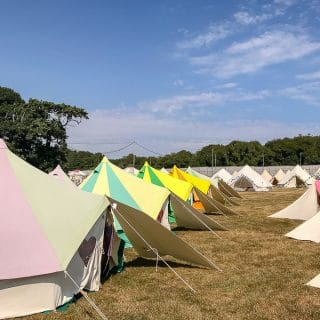 Row of brightly coloured bell tents - Bellepads by Podpads review