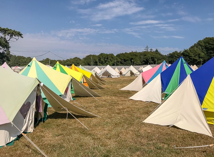Rows of colourful bell tents - Boutique Camping / glamping. Bellepad Podpads Review