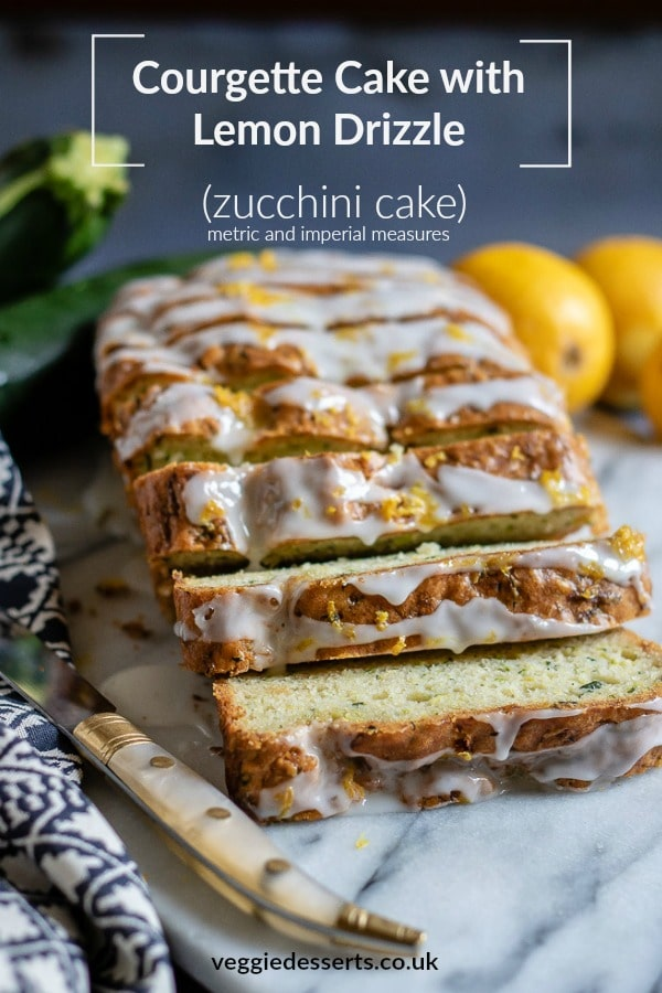 This moist one-bowl zucchini cake / courgette cake is a great way to use up seasonal gluts. The cake has reduced sugar, so much of the sweetness comes from the lemon drizzle. The flavour of the courgette fades away beneath the zingy lemon, but leaves pretty flecks of green. #zucchinirecipe #courgetterecipe #courgettecake #zucchinibread