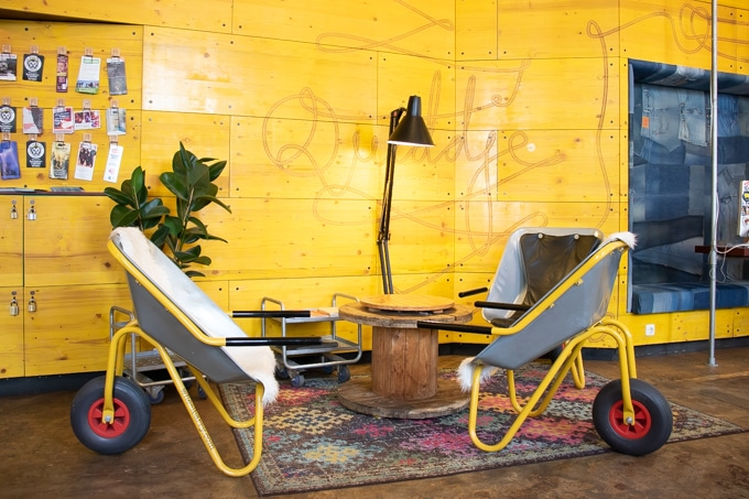 Superbude St Pauli lobby Hamburg Hotel Hostel Wheelbarrow chairs and yellow wall