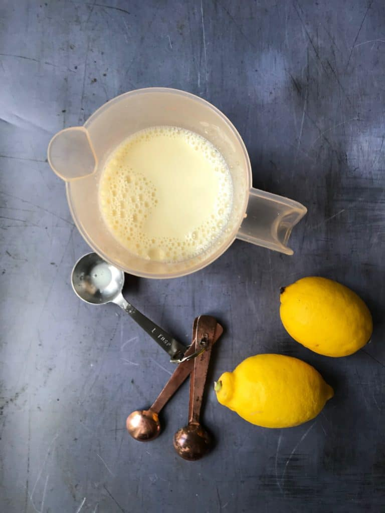 Lemon juice and milk in a jug.