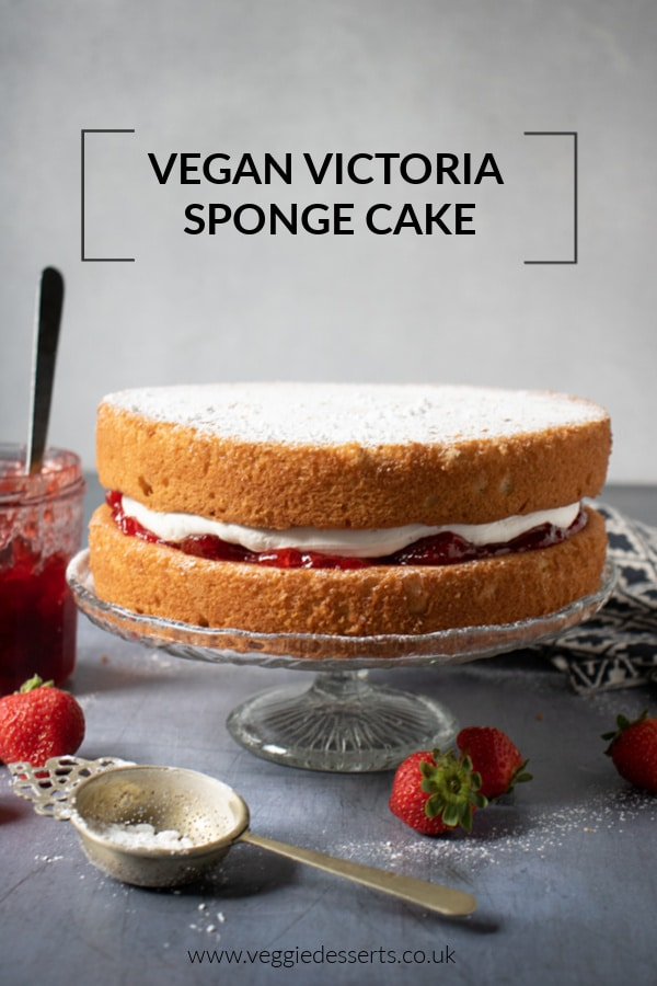 This easy one-bowl vegan Victoria sponge is light, fluffy and absolutely delicious. Strawberry jam and vanilla cream are sandwiched between vanilla sponge cakes. Try this vegan version of the classic British cake recipe. #victoriasponge #victoriasandwich #vegancake #veganvanillacake #veganvictoriasponge