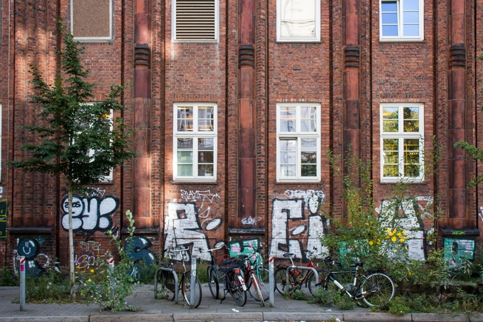 Sternschanze Hamburg - brick building with graffiti and bicycles
