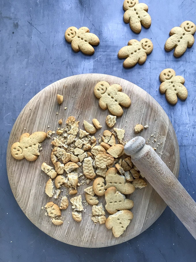 How to make Pear and Gingerbread Parfait - Step 2: Bash the gingerbread men with a rolling pin.
