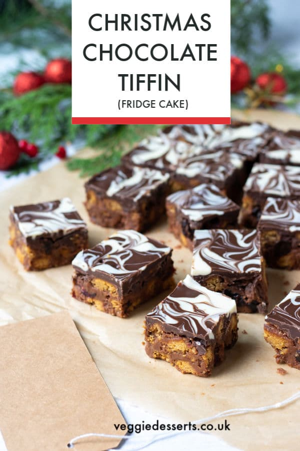 All the best flavours of Christmas combine in this easy tiffin. Crushed ginger biscuits add a little heat, along with the heady spices of cinnamon and nutmeg. The fresh zing of orange is lovely against the rich chocolate and sweet fruit. It's rich, decadent and full of flavour. A perfect edible gift. #ediblegift #tiffin #fridgecake #nobake #Christmasdessert #chocolatetiffin