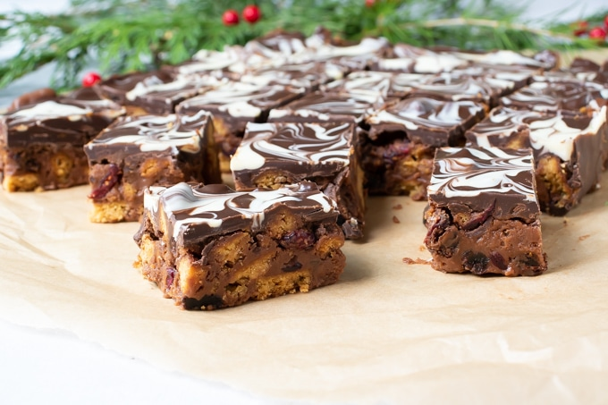 Slices of Christmas Chocolate Tiffin on baking paper.