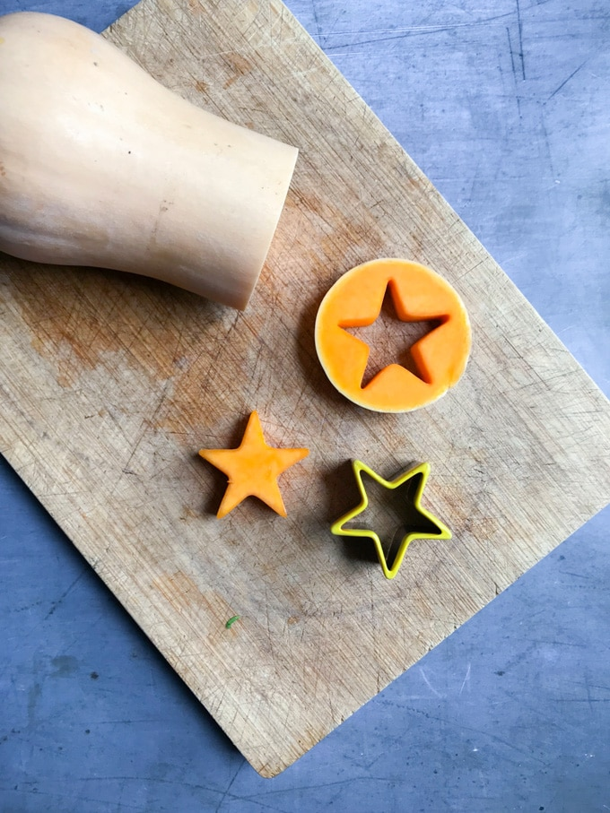 How to make roasted sprout side dish = cut a slice of the butternut squash and use a cookie cutter to cut a star shape