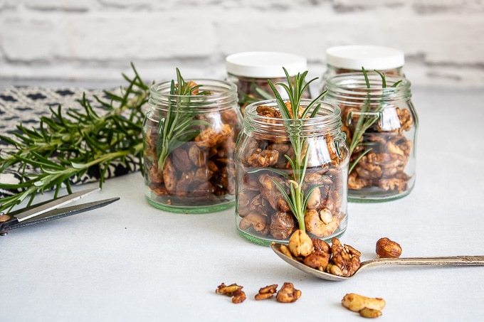 Small jars of Rosemary Maple Spiced Roasted Nuts - an easy recipe perfect for edible gifts.