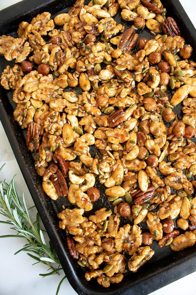 How to make Rosemary Maple Spiced Roasted Nuts - add to a baking sheet in a single layer and roast