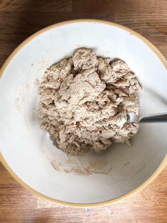 How to make cinnamon scones recipe. Add milk and stir to create a rough dough.
