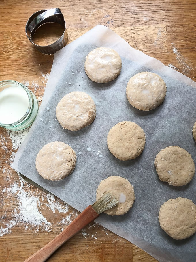 How to make cinnamon scones recipe - brush the rounds with milk and place on a baking tray. Bake in the oven until golden.