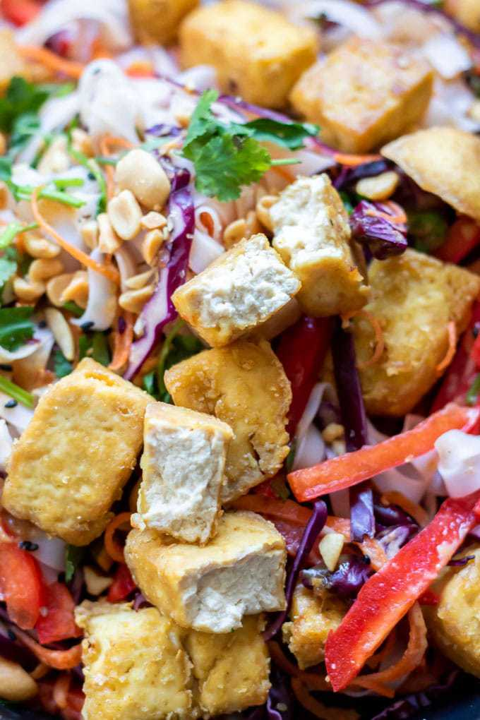 Crispy air fryer tofu on thai noodle salad bowl, with rice noodles, veggies, peanut sauce.