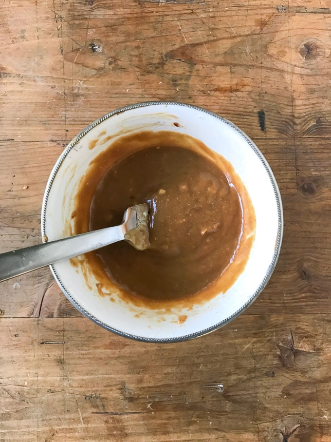 A bowl of peanut sauce.