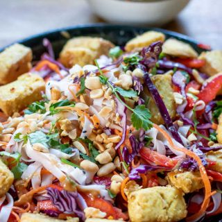 Dish of noodle salad with vegetables and tofu.