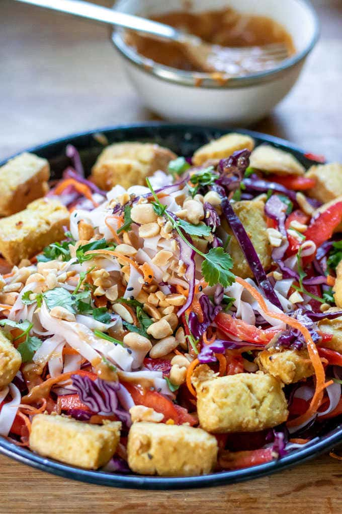 Close up of a Noodle Bowl with air fried tofu.