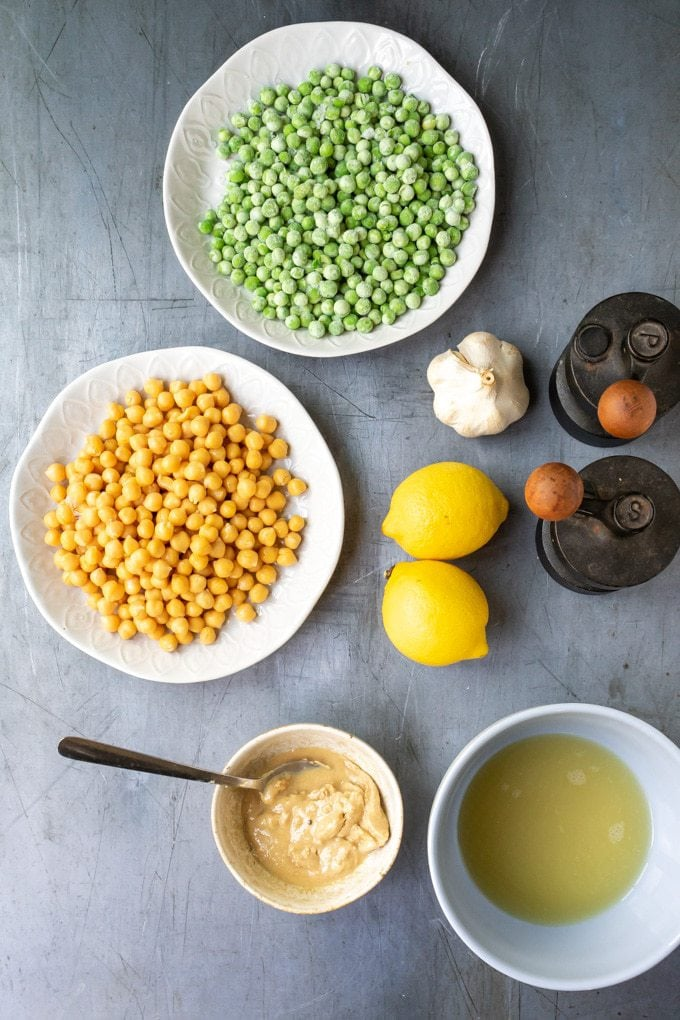Ingredients for pea hummus - peas, chickpeas, aquafaba, tahini, lemon juice, garlic