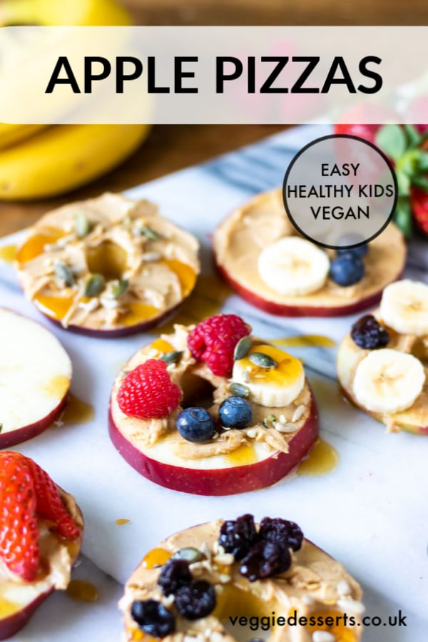 Apple pizzas are a fun and tasty healthy snack for kids that you can customise however they like. They're a super quick recipe for breakfast, lunch, dessert or a snack. Endlessly customisable, this healthy snack will definitely delight children. #healthykidssnacks #healthykidsfood #vegetariankids