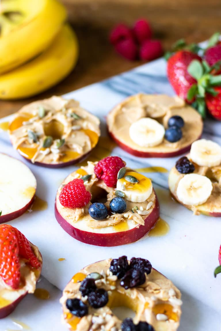 Sliced apples topped with fruit.
