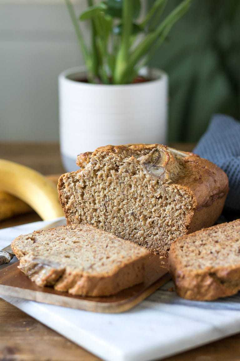 Thick slices of moist and tasty vegan banana cake - an eggless and dairy free banana bread recipe.