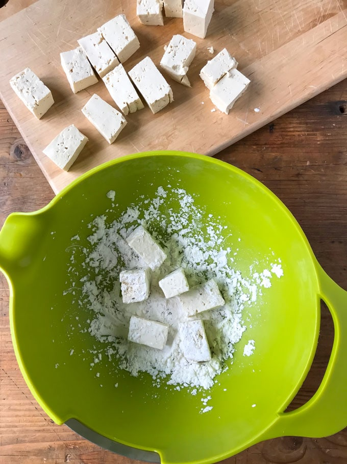 How to make vegan tofu curry recipe: cut the tofu into cubes and toss with the cornstarch / cornflour.