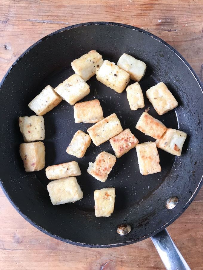 How to make Tofu Curry recipe: fry the coated tofu on all sides until crispy.