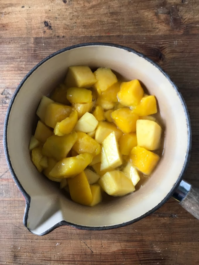 Pot of cooked mango.