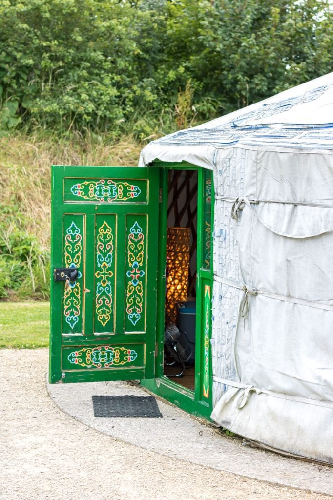 Traditional Mongolian Yurt with the door open. Caalm Camp yurt campsite Dorset.