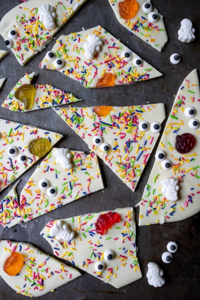 Pieces of white chocolate Halloween bark with candy, edible eyes and sprinkles