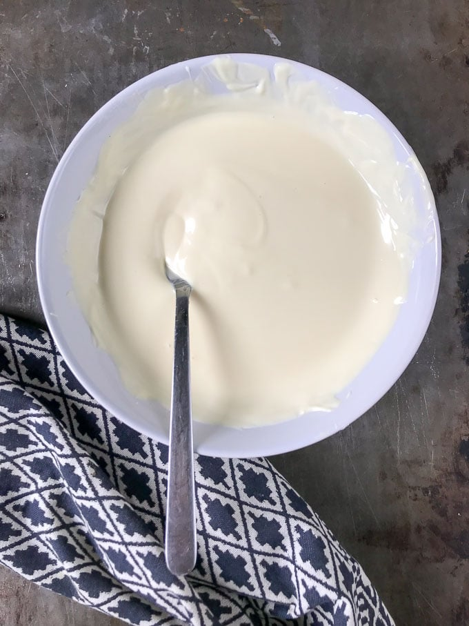 Melted white chocolate in a bowl.