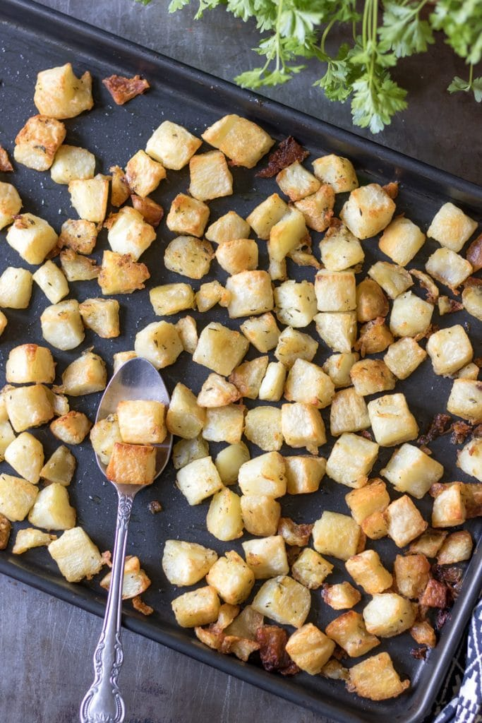 A baking tray with parmentier potatoes - roasted diced potatoes recipe.