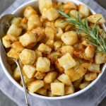 Overhead shot of a bowl of diced cubed Parmentier Potatoes - a French vegan potato side dish recipe.