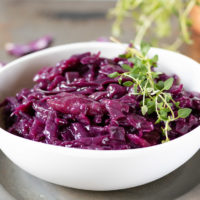 A bowl of braised red cabbage - a spiced side dish that's perfect for Thanksgiving, Christmas or roast dinners