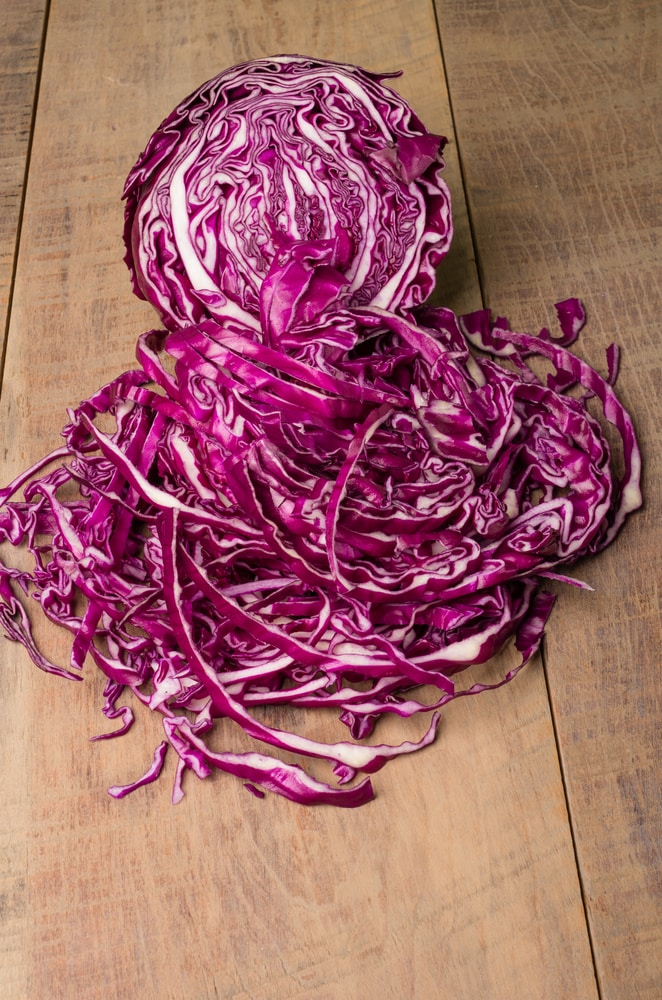 sliced red cabbage on a wooden board