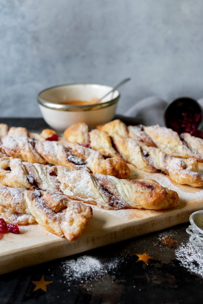 Cinnamon puff pastry twists on a wooden board