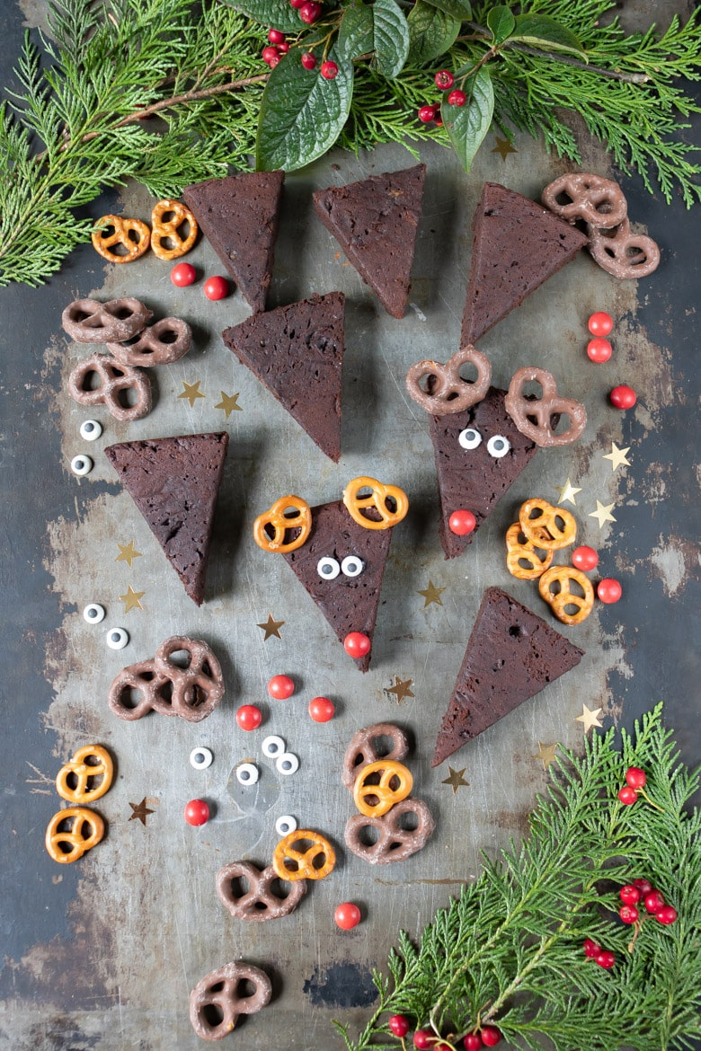 Making avocado reindeer brownies, adding the candy decorations