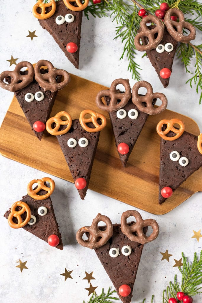 Avocado Reindeer Brownies, healthier Christmas treats with candy eyes and noses and pretzel antlers.