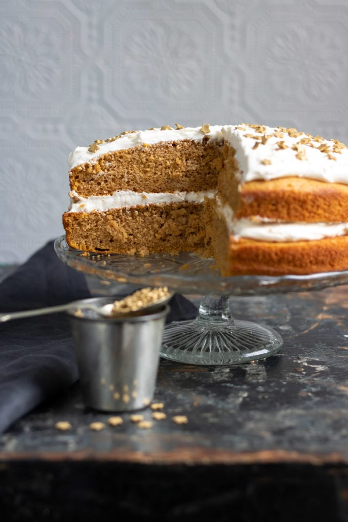 A pumkin spiced vegan layer cake with ginger frosting and sprinkles.
