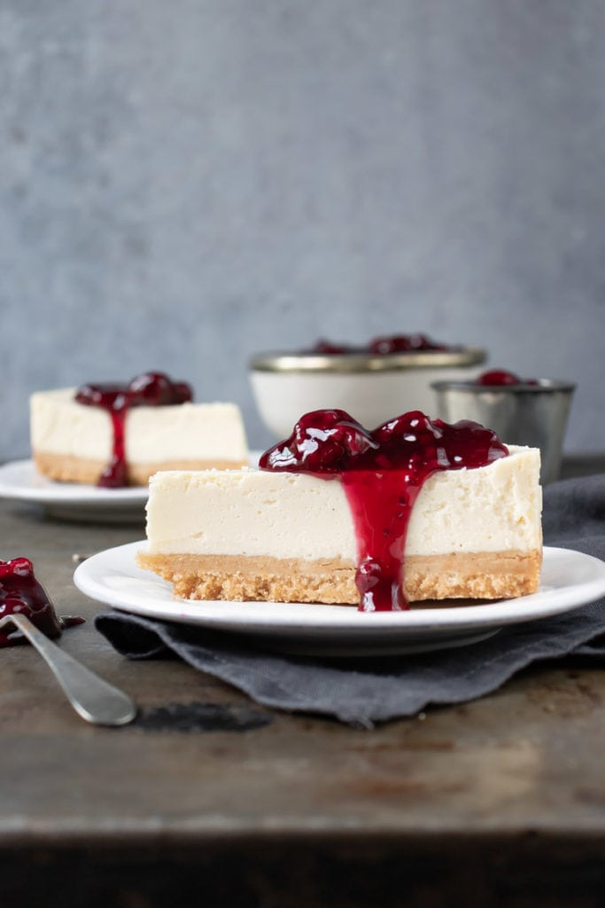 Side view of a slice of cheesecake.