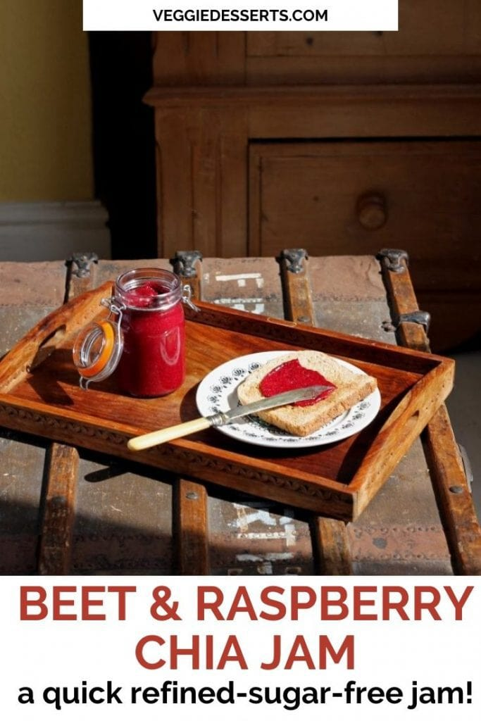A tray with toast and a jar of raspberry beet chia jam.