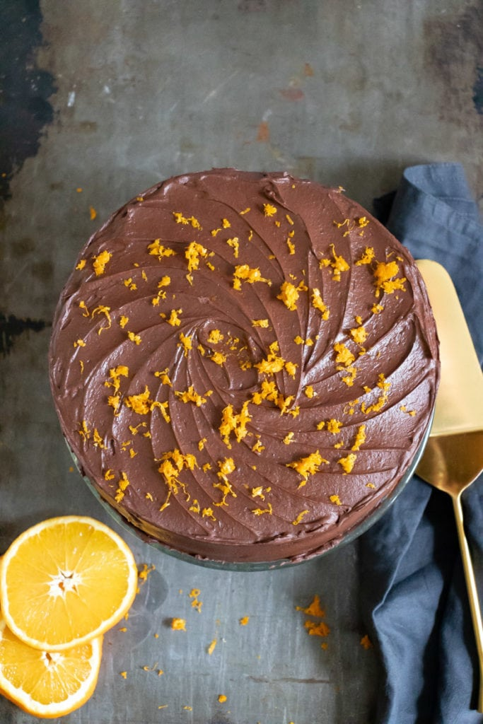 Overhead shot of a Chocolate Orange Cake with chocolate frosting spinkled with orange zest.