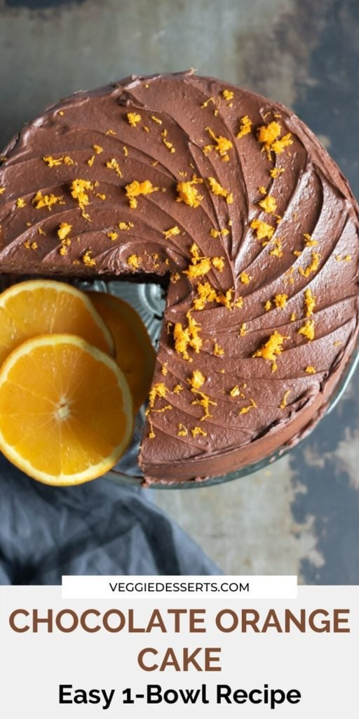 Pinnable image for Chocolate Orange Cake with slices of orange next to the cake with a slice cut out.