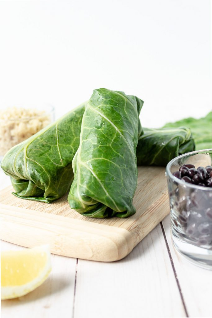 Collard wraps on a board.