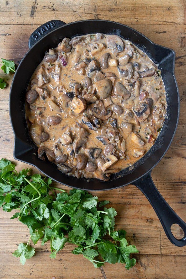Cast iron skillet filled with creamy mushrooms